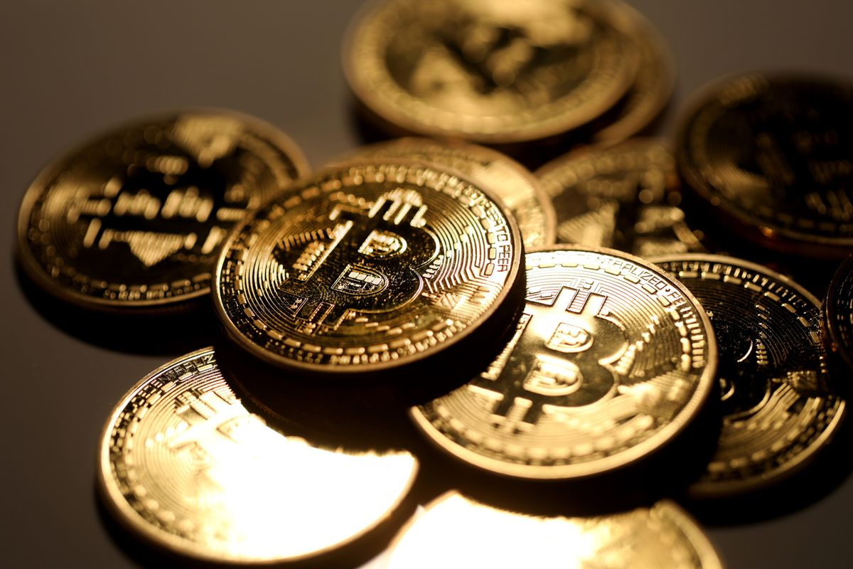 A pile of coins representing Bitcoin cryptocurrency sit grouped together in this arranged photograph in London, U.K., on Wednesday, Feb. 7, 2018. Cryptocurrencies tracked by Coinmarketcap.com have lost more than $500 billion of market value since early January as governments clamped down, credit-card issuers halted purchases and investors grew increasingly concerned that last year's meteoric rise in digital assets was unjustified.